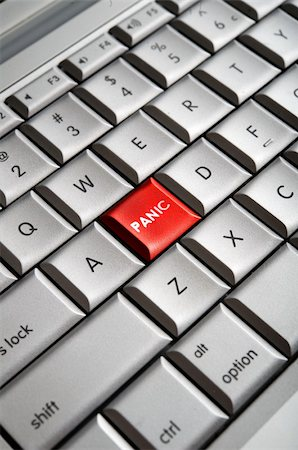 Close-up image of a red panic button on a traditional computer keyboard Stock Photo - Budget Royalty-Free & Subscription, Code: 400-04170373