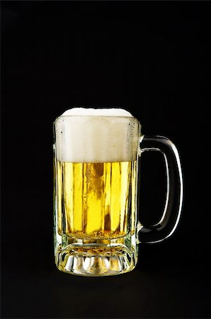 Image of a mug of beer on black background Stock Photo - Budget Royalty-Free & Subscription, Code: 400-04170891