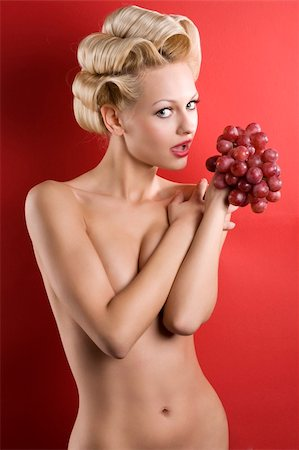 Beautiful naked blond woman over red background with some red grape looking in camera Stock Photo - Budget Royalty-Free & Subscription, Code: 400-04184505