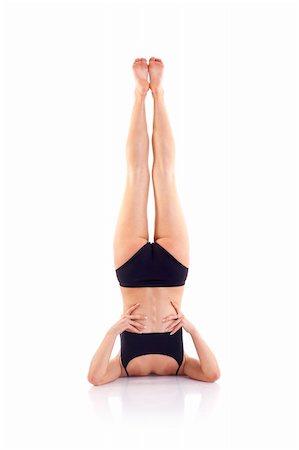 feet gymnast - beautiful girl doing gymnastics on white background Stock Photo - Budget Royalty-Free & Subscription, Code: 400-04185543