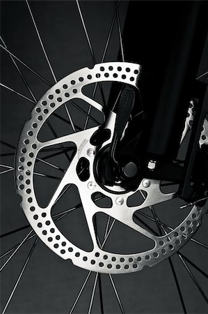 Mountain bike front wheel with mechanical disc brake Stock Photo - Budget Royalty-Free & Subscription, Code: 400-04180144