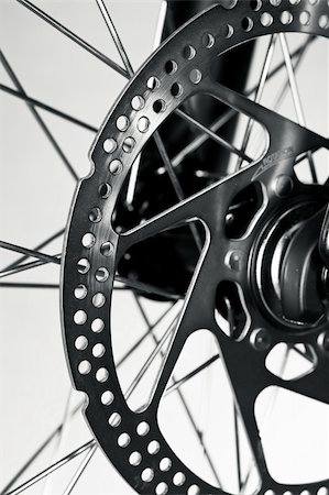 Disc brake rotor on a mountain bike front wheel Stock Photo - Budget Royalty-Free & Subscription, Code: 400-04180141