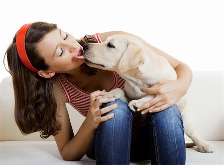 dog kissing girl - Beautiful girl receiving a kiss from her best friend, a nice and cute dog Stock Photo - Budget Royalty-Free & Subscription, Code: 400-04181937