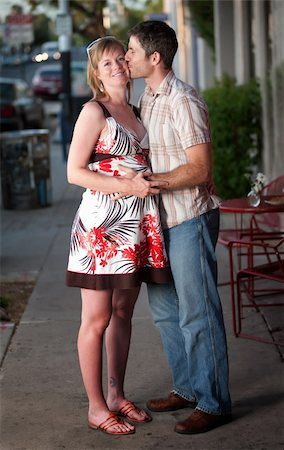 Pregnant woman kissed by her partner on the street Stock Photo - Budget Royalty-Free & Subscription, Code: 400-04194257