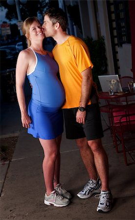 Pregnant woman and husband in fitness attire on the street Stock Photo - Budget Royalty-Free & Subscription, Code: 400-04194266
