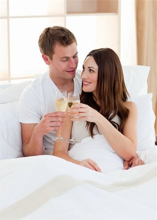 Intimate couple drinking champagne lying in bed at home Stock Photo - Budget Royalty-Free & Subscription, Code: 400-04197305