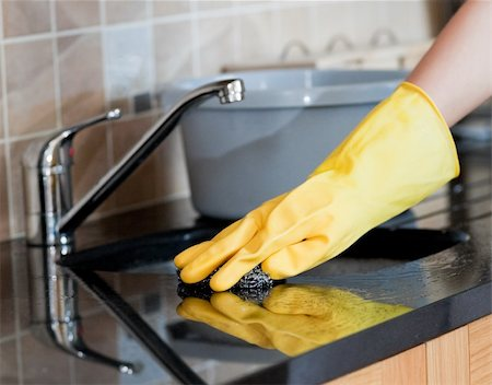 Close-up of a woman cleaning a kitchen at home Stock Photo - Budget Royalty-Free & Subscription, Code: 400-04198640