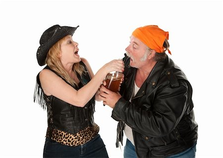 Gang member couple wrestling over a beer bottle Stock Photo - Budget Royalty-Free & Subscription, Code: 400-04199636