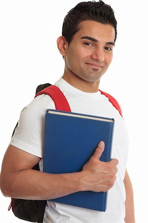 Smiling male college or university student carrying a textbook and backpack Stock Photo - Budget Royalty-Free & Subscription, Code: 400-04190504