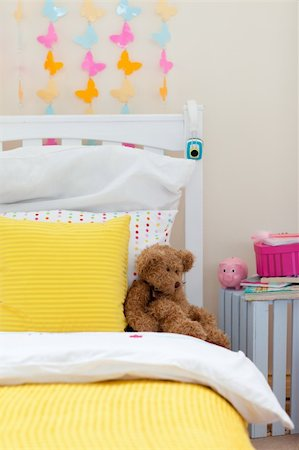Close-up of child's bedroom with a teddy bear on the bed Stock Photo - Budget Royalty-Free & Subscription, Code: 400-04193357