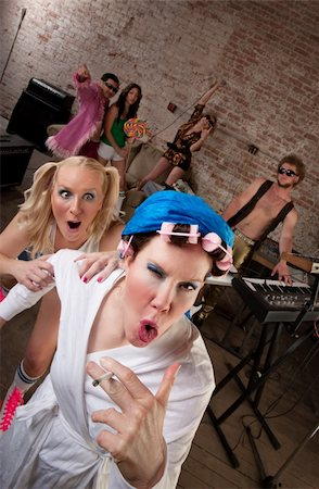 Wild neighbor acting foolishly with young partygoers Stock Photo - Budget Royalty-Free & Subscription, Code: 400-04206686