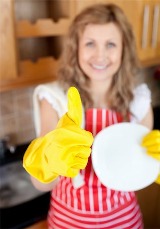rubber apron woman - Cheerful woman with thumb up drying dish in a kitchen Stock Photo - Budget Royalty-Free & Subscription, Code: 400-04201203