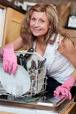 Charming young woman using a dishwasher in the kitchen Stock Photo - Budget Royalty-Free & Subscription, Code: 400-04202339