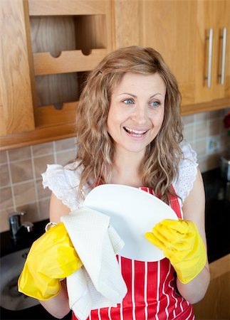 rubber apron woman - Laughing blond woman drying dishes in the kitchen Stock Photo - Budget Royalty-Free & Subscription, Code: 400-04202344