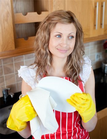 rubber apron woman - Smiling caucasian woman drying dishes in the kitchen Stock Photo - Budget Royalty-Free & Subscription, Code: 400-04202343