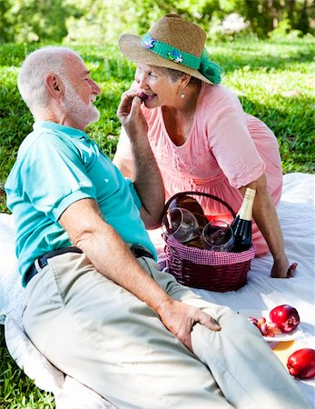 Romantic senior couple on a picnic.  He's feeding her grapes. Stock Photo - Budget Royalty-Free & Subscription, Code: 400-04203915