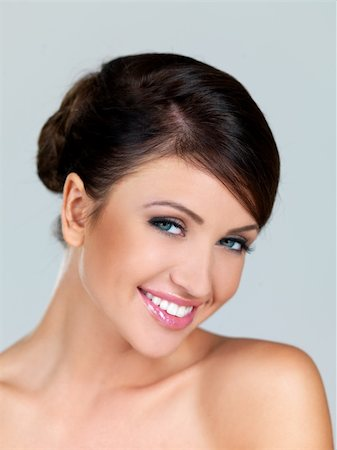 Portrait of beautiful woman, she is smiling Stock Photo - Budget Royalty-Free & Subscription, Code: 400-04214113