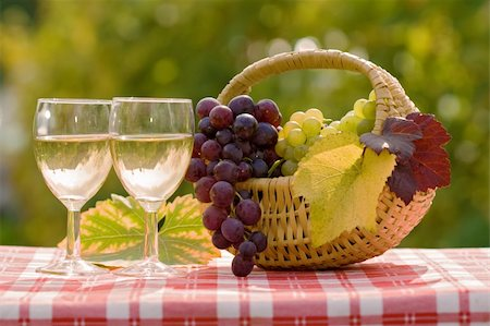 Two glasses of wine and fresh grapes in autumn, after harvest Stock Photo - Budget Royalty-Free & Subscription, Code: 400-04210309