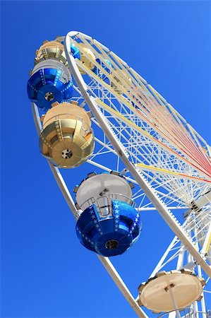 Detail of Merry-go-round against blue sky Stock Photo - Budget Royalty-Free & Subscription, Code: 400-04210702