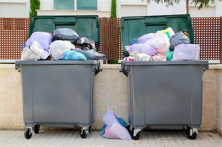 Trash garbage full of bags container in street Stock Photo - Budget Royalty-Free & Subscription, Code: 400-04224984