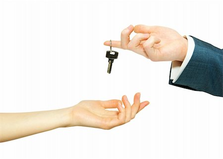 simsearch:400-05936191,k - hand holds a key isolated on white Stock Photo - Budget Royalty-Free & Subscription, Code: 400-04229114