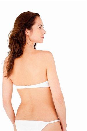 Positive hispanic woman wearing bikini against a white background Stock Photo - Budget Royalty-Free & Subscription, Code: 400-04220818