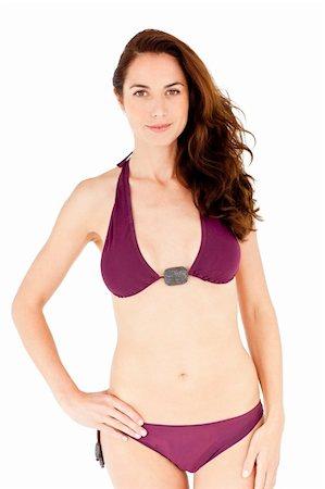 Cute hispanic woman wearing bikini against a white background Stock Photo - Budget Royalty-Free & Subscription, Code: 400-04220819
