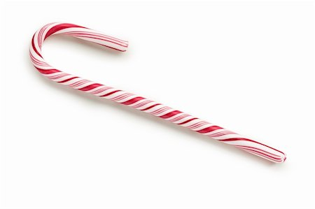red stick candy - stripy candy cane on white background Stock Photo - Budget Royalty-Free & Subscription, Code: 400-04221438