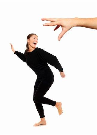 running away scared - A picture of young woman running away from big hand, a lot of concepyual meanings Stock Photo - Budget Royalty-Free & Subscription, Code: 400-04237856