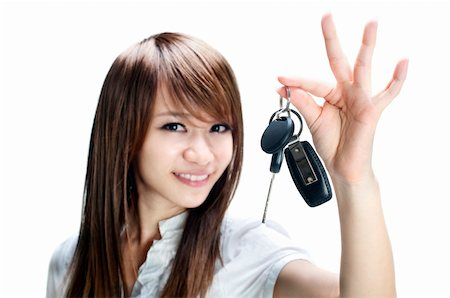 Young girl holding car key on white background Stock Photo - Budget Royalty-Free & Subscription, Code: 400-04238208