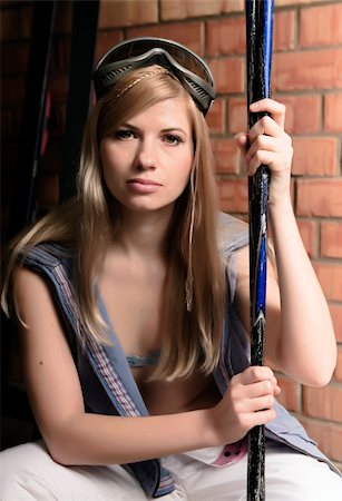 Young sexy blonde with skis. Mountain-skier.Studio. Brick background. Stock Photo - Budget Royalty-Free & Subscription, Code: 400-04239529