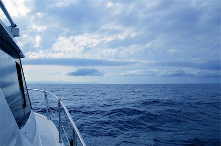 sailing boat storm - Boat sailing in cloudy stormy day blue ocean sea, yacht side view Stock Photo - Budget Royalty-Free & Subscription, Code: 400-04231364