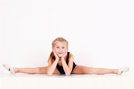 Cute little girl making splits on white background Stock Photo - Budget Royalty-Free & Subscription, Code: 400-04232566