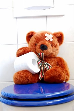 toy teddy bear with paper in the bathroom on toilet Stock Photo - Budget Royalty-Free & Subscription, Code: 400-04241435