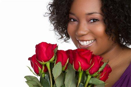 dozen roses - Beautiful black woman holding roses Stock Photo - Budget Royalty-Free & Subscription, Code: 400-04257993
