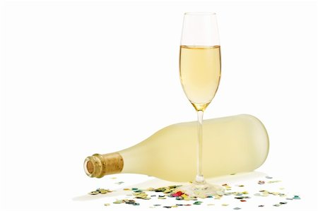 party celebration paper confetti - glass of champagne in front of dull prosecco bottle with confetti on white background Stock Photo - Budget Royalty-Free & Subscription, Code: 400-04266424