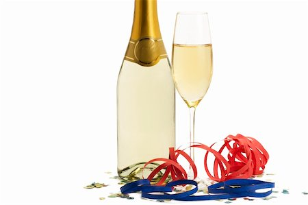 party celebration paper confetti - glass of champagne with blow-outs and confetti in front of a champagne bottle on white background Stock Photo - Budget Royalty-Free & Subscription, Code: 400-04266429