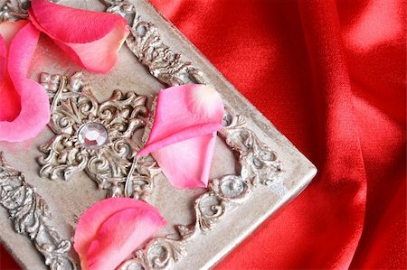 silver box - Pink rose petals on a silver ornate box Stock Photo - Budget Royalty-Free & Subscription, Code: 400-04266782