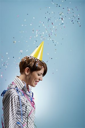 party celebration paper confetti - caucasian woman with confetti and streamers on shirt. Vertical shape, side view, waist up, copy space Stock Photo - Budget Royalty-Free & Subscription, Code: 400-04267317