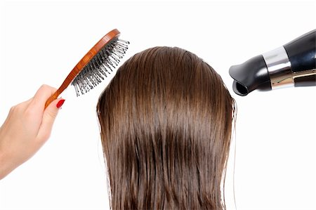 Picture of the back of a woman with long hair over white background trying to dry hair Stock Photo - Budget Royalty-Free & Subscription, Code: 400-04261609