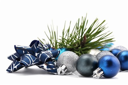 Fancy bow with blue and silver Christmas ornaments and a pine twig isolated on white background. Shallow dof Stock Photo - Budget Royalty-Free & Subscription, Code: 400-04262101