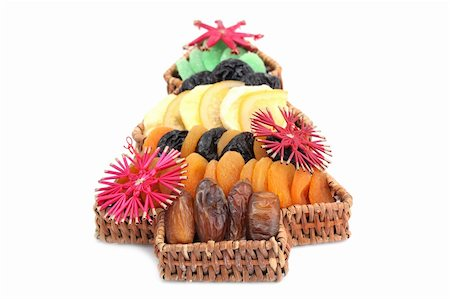 Wicker basket in the shape of Christmas tree with variety of dried fruits isolated on white background. Shallow dof Stock Photo - Budget Royalty-Free & Subscription, Code: 400-04262110