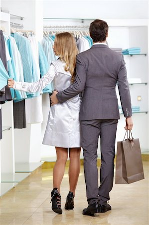 The woman and the man leave clothes shop Stock Photo - Budget Royalty-Free & Subscription, Code: 400-04262998