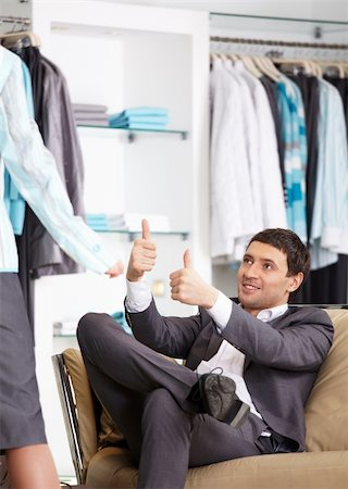 The young man advises to the girl in clothes choice Stock Photo - Budget Royalty-Free & Subscription, Code: 400-04262999
