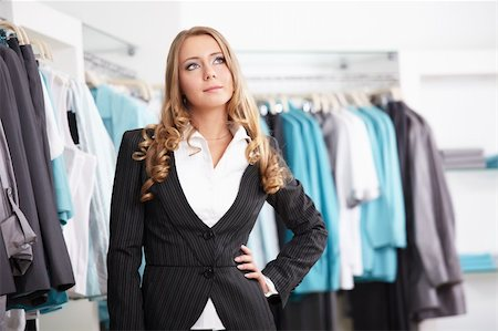 The beautiful young girl in clothes shop Stock Photo - Budget Royalty-Free & Subscription, Code: 400-04262990