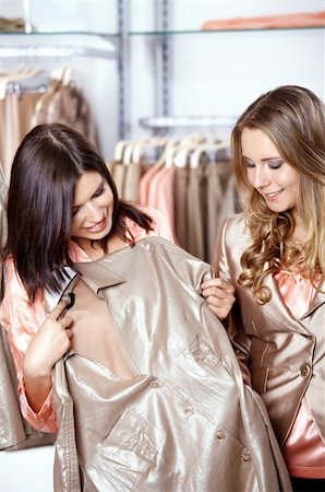 Two girls consider a shirt in shop Stock Photo - Budget Royalty-Free & Subscription, Code: 400-04263003