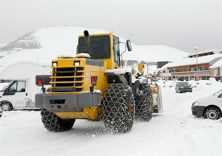 snow plow truck - Snowplow machine in winter in an alpine region Stock Photo - Budget Royalty-Free & Subscription, Code: 400-04274525