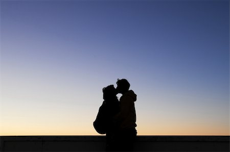 Silhouette of kissing couple Stock Photo - Budget Royalty-Free & Subscription, Code: 400-04275178