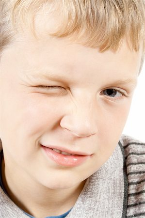 close-up portrait of a winking blonde boy Stock Photo - Budget Royalty-Free & Subscription, Code: 400-04275890