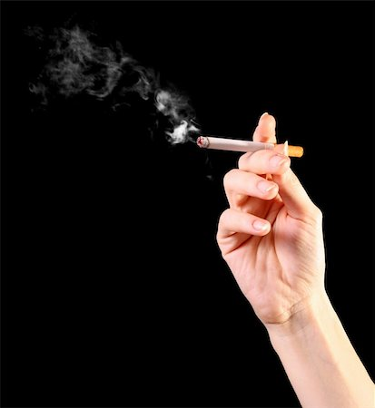 woman hand holding a cigarette with smoke Stock Photo - Budget Royalty-Free & Subscription, Code: 400-04276895
